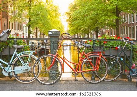 Bikes on the bridge in Amsterdam Netherlands - stock photo