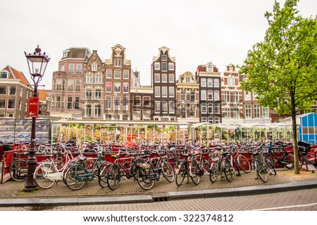 Bikes on the street in Amsterdam, Netherlands - stock photo