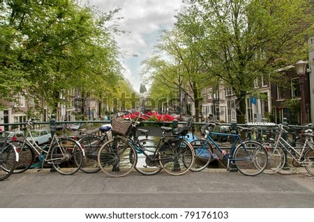 Bikes parked on a bridge in Amsterdam, Netherlands - stock photo