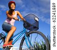 Biking under deep blue sky in the countryside of Jutland, Denmark during summer. Beautiful happy woman. - stock photo