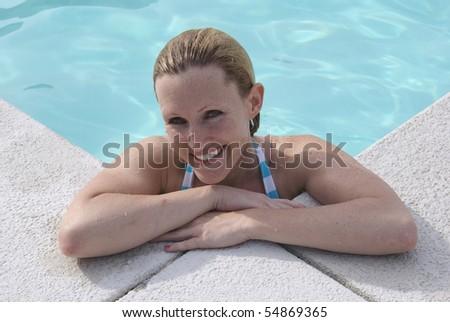 Bikini Blond at the Pool smiling - stock photo