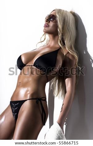 Bikini Fashion Model with a beach towel - stock photo