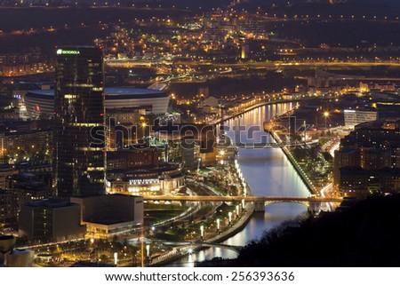 BILBAO CITY - december 21. Nightfall in the city of Bilbao on december 21, 2014. Nightfall in the city and river nervion. Bilbao, Bizkaia, Spain - stock photo