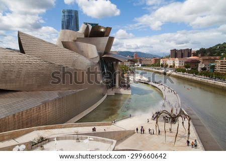 BILBAO, SPAIN - AUGUST 13: Guggenheim Bilbao museum on August 13, 2014 in Bilbao, Spain. Desgined by Frank Gehry, was completed in 1997. - stock photo