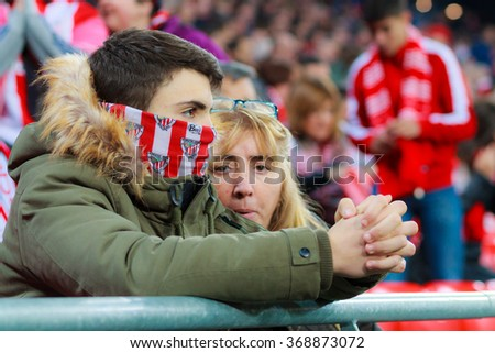BILBAO, SPAIN - JANUARY 20: Two unidentified Athletic Club Bilbao fans during the quarter-finals of the Cup match between Athletic Club Bilbao, celebrated on January 20, 2016, in Bilbao, Spain - stock photo