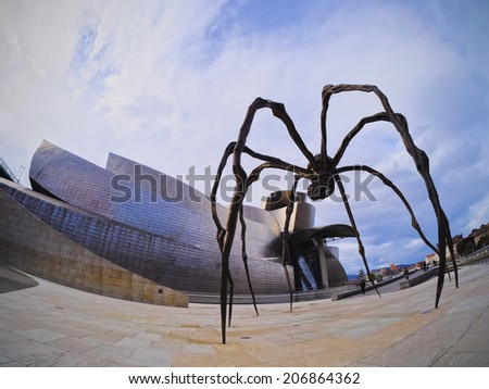 BILBAO, SPAIN - MARCH 8, 2013: Maman - spider sculpture by the artist Louise Bourgeois in front of The Guggenheim Museum in Bilbao, Biscay, Basque Country, Spain
