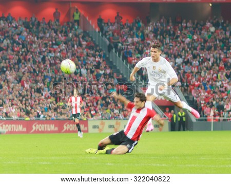 BILBAO, SPAIN - SEPTEMBER 23: Cristiano Ronaldo shoots on goal in front of one opposing player in the San Mames Stadium, on September 23, 2015 in Bilbao, Spain - stock photo