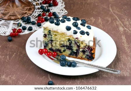Bilberry cake with frosting - stock photo