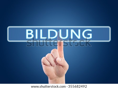 Bildung - german word for education - hand pressing button on interface with blue background.