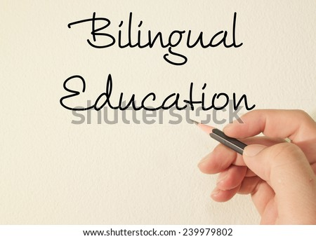Bilingual education text write on wall  - stock photo