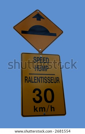 Bilingual speed hump sign sign isolated on blue - stock photo
