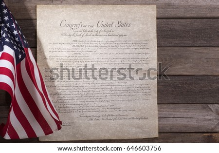 Bill of rights with United States flag on a wood background