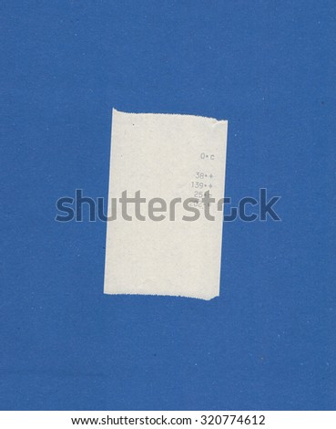 bill or receipt isolated over blue background - stock photo