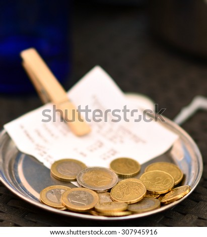 Bill with a change close up - stock photo