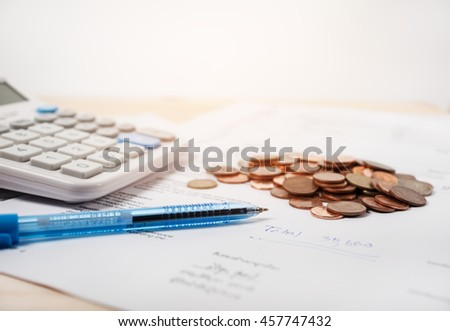 Bill with calculator and coins and pen on white background vintage style - stock photo