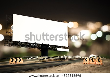 billboard and bridge with bokeh light in city night time background - stock photo