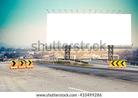 billboard and bridge with sky and city background - stock photo