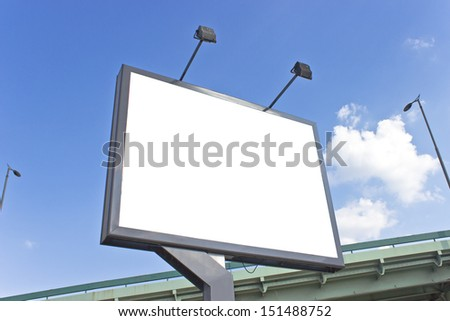 Billboard at highway over blue sky - stock photo