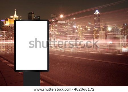 Billboard, banner empty, white at a bus stop on the highway during the twilight with city background with clipping path on screen.- can be used for display your products or promotional