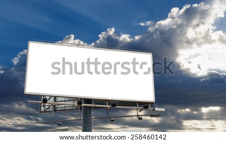Billboard Blank Screen in front of beautiful cloudy sky with sun-rays - stock photo