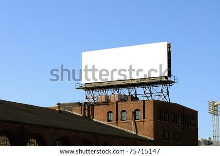 Billboard on Brick Building - stock photo