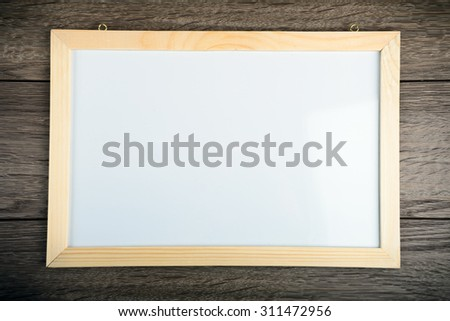 billboard on the wooden table - stock photo