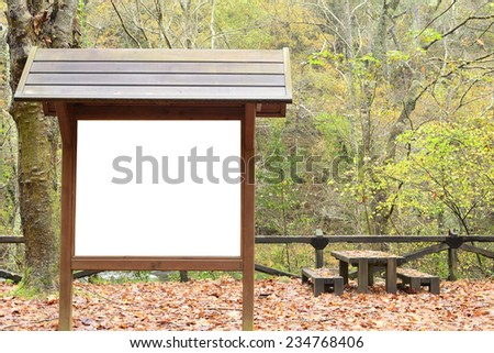 Billboard, picnic, recreation facilities, natural park. Autumn scene