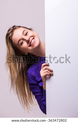 Billboard sign woman smiling. Casual business woman showing blank white placard .  Caucasian female model isolated on white background. - stock photo