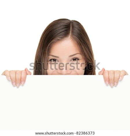 Billboard woman looking over sign isolated on white background. Mixed race Asian Caucasian female model looking. - stock photo