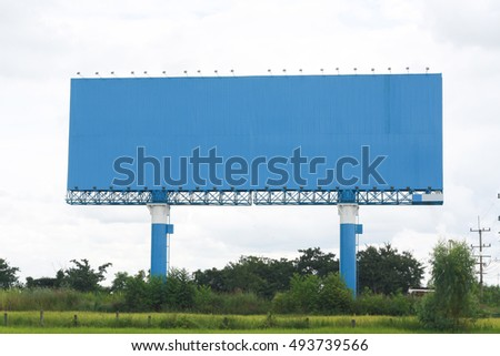Billboards Space Blue Outdoors in the middle of green fields.