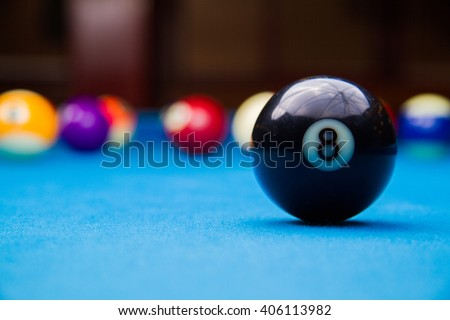 billiard 8 ball on blue billiard table