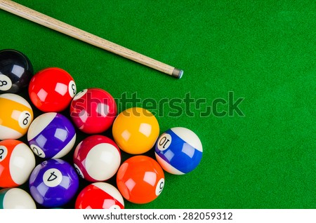 Billiard balls on green table with billiard cue, Snooker, Pool game. - stock photo