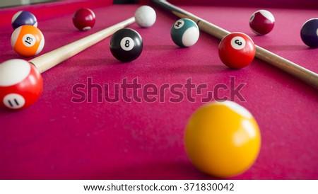 Billiard balls on the table. Selective focus - stock photo