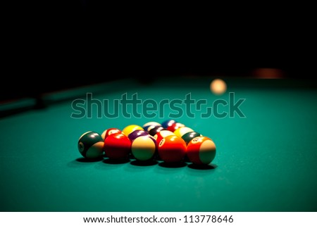 Billiard balls that ready for the break on the green table - stock photo