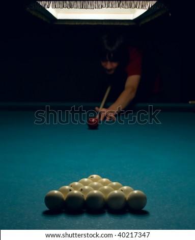 Billiard player doing first shoot - stock photo