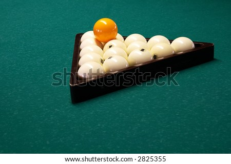 Billiard spheres in a triangle on a table - stock photo