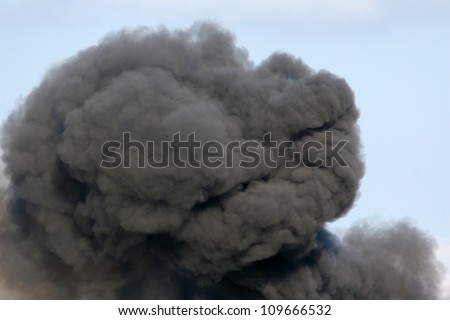 Billowing Black Smoke from a Gasoline and Dynamite Explosion - stock photo