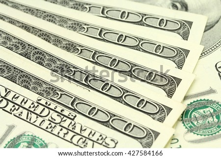bills of one hundred dollars amenrikanskih abstract background - stock photo