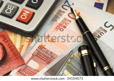 bills,pen and calculator close up - stock photo