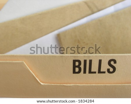 Bills section of filing cabinet with envelopes inside it. - stock photo