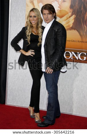 Billy Ray Cyrus and Tish Cyrus at the Los Angeles premiere of 'The Last Song' held at the ArLight Cinemas in Hollywood, USA on March 25, 2010. - stock photo