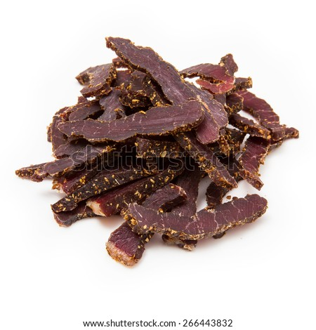 Biltong South African beef jerky isolated on a white studio background. - stock photo