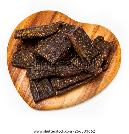 Biltong South African beef jerky meat isolated on a white studio background.