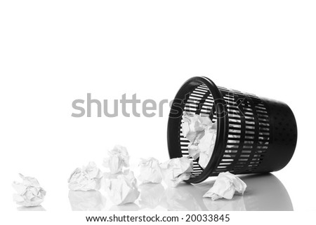 bin filled with crumpled paper ,smooth reflection - stock photo