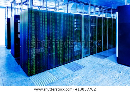 binary code covers a portion of the mainframe in the data center - stock photo