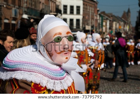 BINCHE, BELGIUM - MARCH 8: Gille in mask performs a round dance at Carnaval de Binche on March 8, 2011 in Binche, Belgium . Carnival in Binche is included in a list of intangible heritage by UNESCO. - stock photo