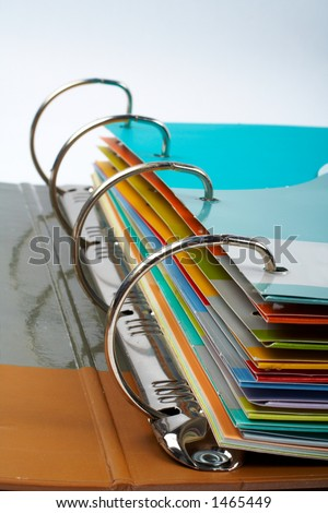 Binder closeup with files stacked (small DOF) - stock photo
