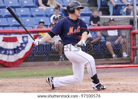 BINGHAMTON, NY - JULY 7:  Binghamton Mets Alan Dykstra takes a big swing during a game against the Portland Sea Dogs at NYSEG Stadium on July 7, 2011 in Binghamton, NY - stock photo