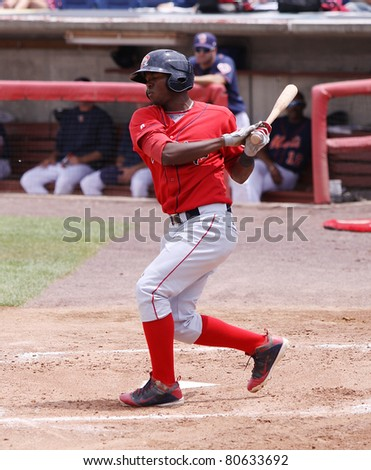 BINGHAMTON, NY - JULY 7: Portland Sea Dogs batter Oscar Tejada swings and misses during a game against the Binghamton Mets at NYSEG Stadium on July 7, 2011 in Binghamton, NY - stock photo