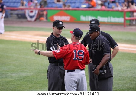 BINGHAMTON, NY - JULY 7: Portland Sea Dogs manager Kevin Boles has a discussion with the umpires in a game against the Binghamton Mets at NYSEG Stadium on July 7, 2011 in Binghamton, NY - stock photo
